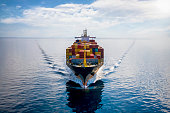 istock Aerial front view of a loaded container cargo vessel 1284416170