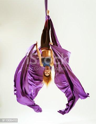 istock Aerial gymnast acrobat hanged on fabric 911305410