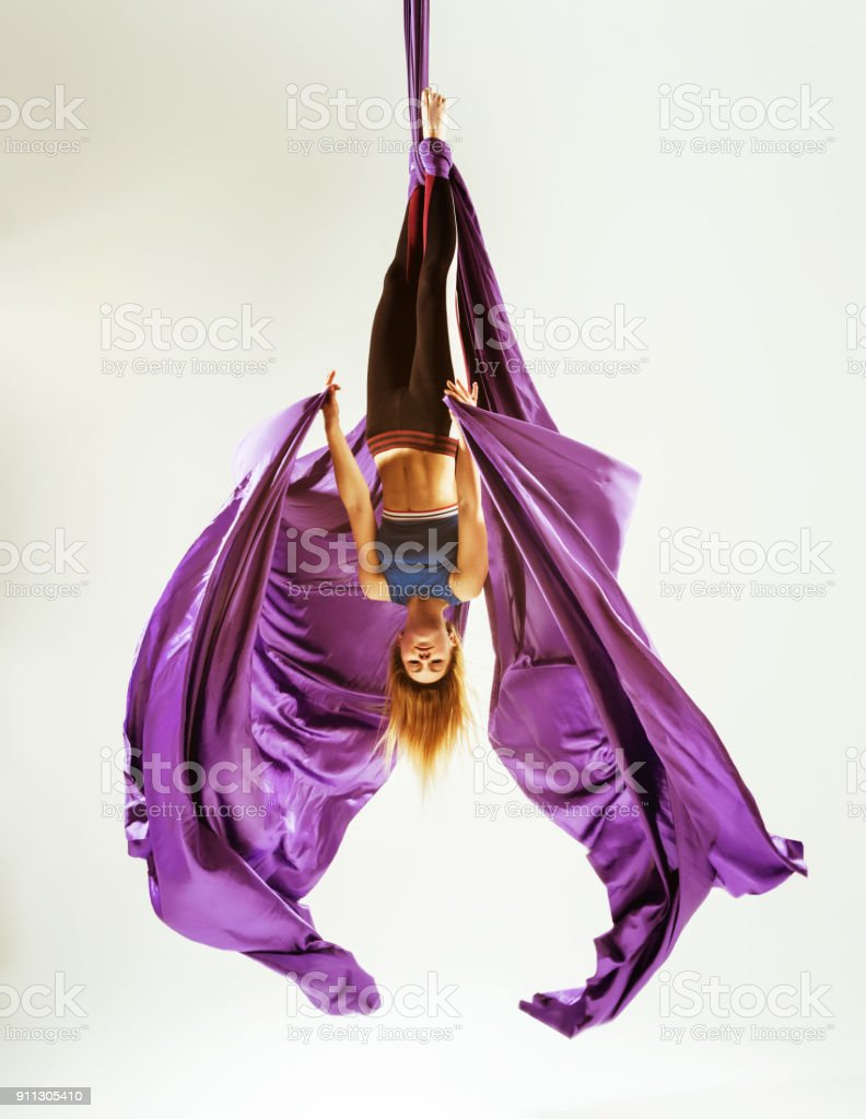 Aerial gymnast acrobat hanged on fabric stock photo