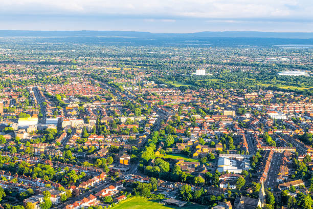 Aerial high angle above view from airplane over city suburbs of London in United Kingdom with Twickenham neighborhood in summer stock photo