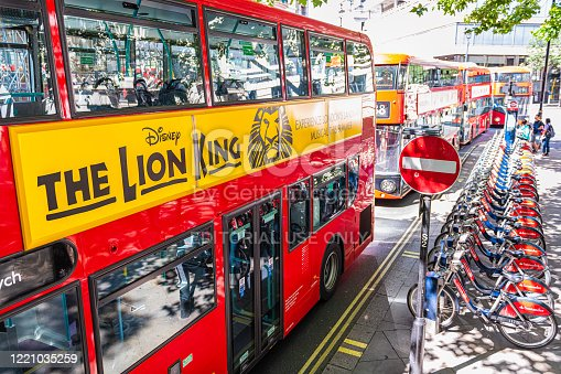 London, UK - June 22, 2018: Aerial high angle above view on street in Lodnon for signs ad for Disney Lion King on red bus by bicycle rack parking in summer