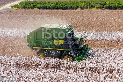 North District, Israel - October 4, 2019: Aerial image of a John Deere CP690 Six row Cotton picker working in a field.