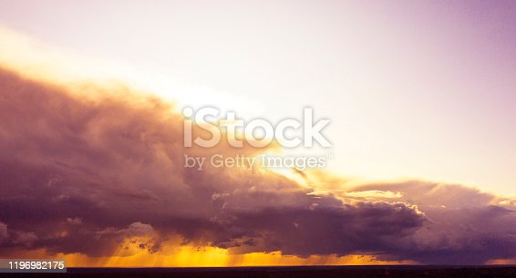 621591180 istock photo Aerial image of dark Storm clouds over the land. Aerial panorama of storm clouds. Panorama of thunder clouds. View from drone. Aerial bird's eye view. Aerial top view cloudscape. Texture of clouds. 1196982175