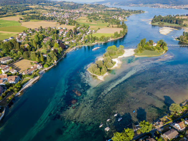 Aerial image of Lake of Constance with Werd Islet in summer 2018, which has the least rainfall in Europe since 150 years Aerial image of Lake of Constance with Werd Islet in summer 2018, which has the least rainfall in Europe since 150 years. In the lake shallow places are seen. Bodensee stock pictures, royalty-free photos & images