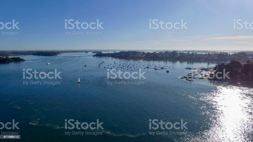 Aerial image of the Port of the Monks Island, located in the Gulf of Morbihan, Brittany, France, one of the world's most beautiful bays. stock photo