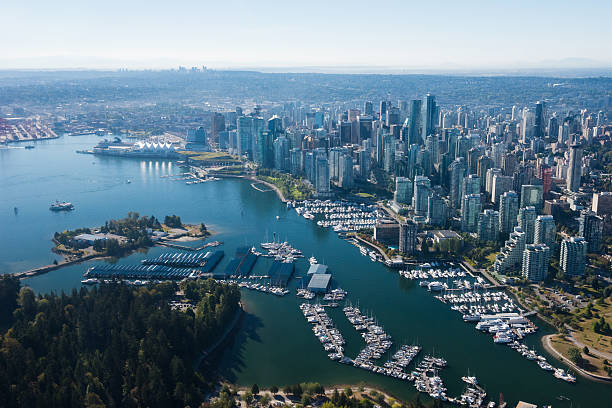 Aerial Image of Vancouver, British Columbia, Canada Aerial Image of Vancouver, British Columbia, Canada with Stanley Park, downtown and waterfront british columbia stock pictures, royalty-free photos & images