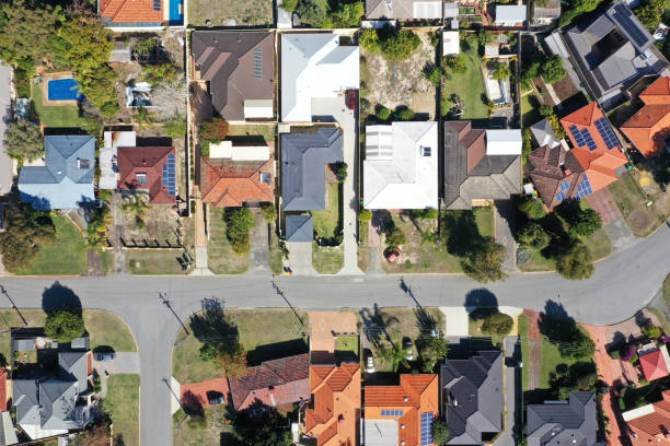 Aerial landscape view from a drone of houses in a quite suburban neighborhood stock photo