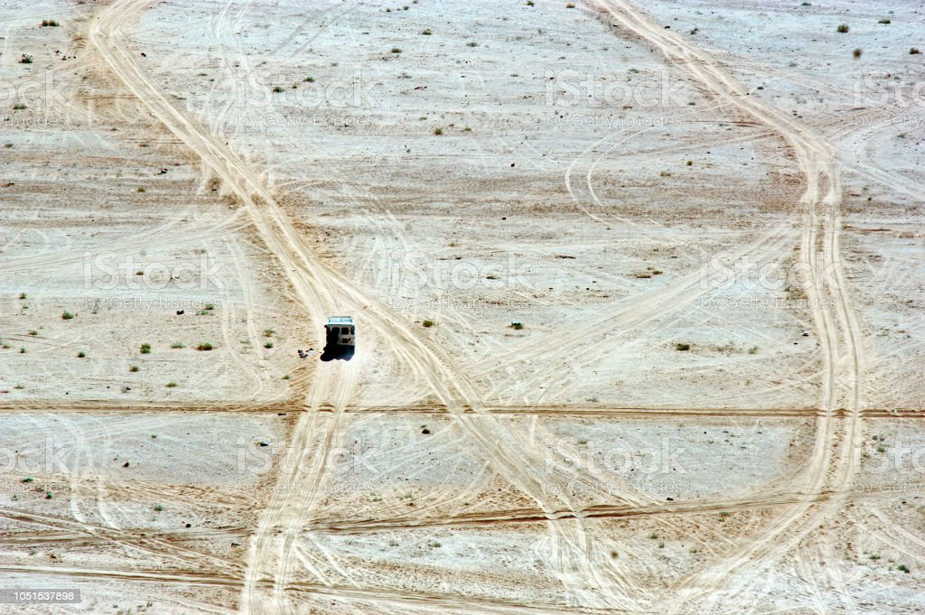 Aerial landscape view of 4WD vhicle journey over off road  trails in a desert stock photo