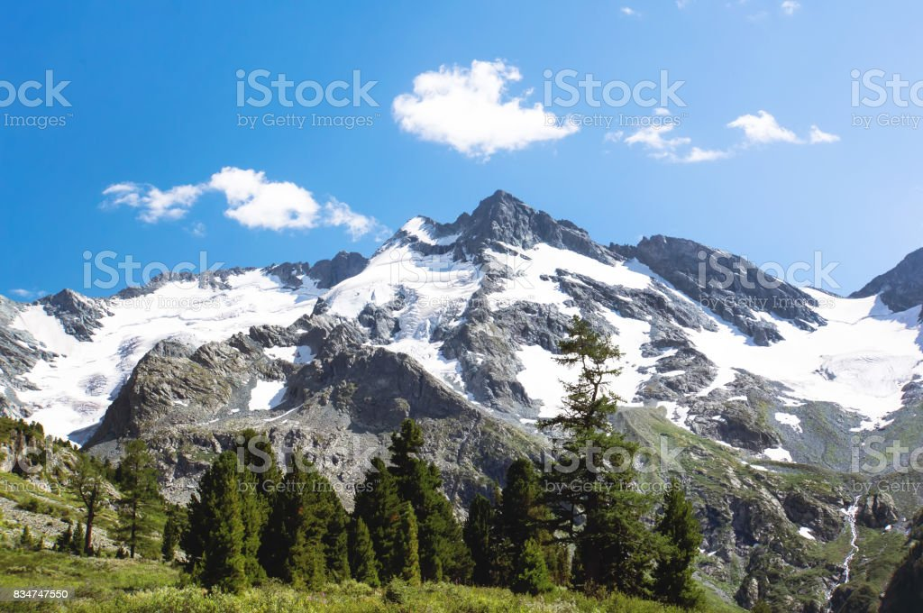 Aerial landscape view of the mountain range covered in snow. stock photo