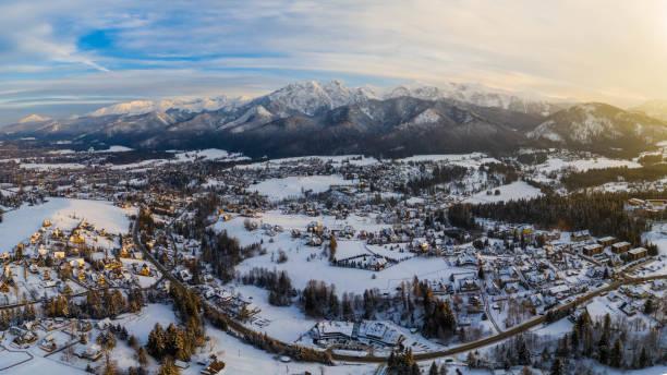 Aerial landscape with tatra mountains and Zakopane, winter scenery of Giewont Peak. stock photo