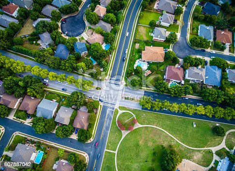 istock Aerial Looking straight down Suburban Intersection 607887042