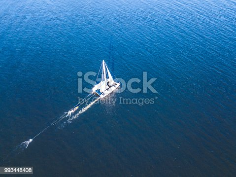 1066331604 istock photo aerial luxury trip yacht shopping in the open sea isolated during summer 993448408