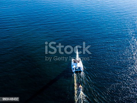 1066331604 istock photo aerial luxury trip yacht shopping in the open sea isolated during summer 993448432