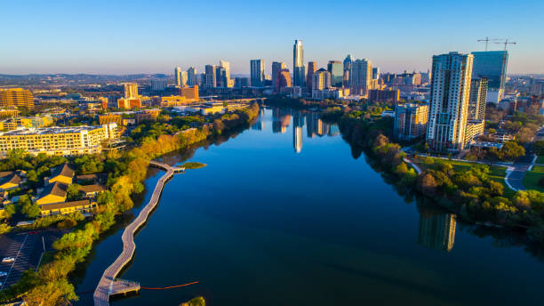 Aerial Morning Austin Texas Colorado Sunrise above Riverside Pedestrian Walking Bridge Aerial Morning Austin Texas Colorado Sunrise above Riverside Pedestrian Walking Bridge colorado river stock pictures, royalty-free photos & images