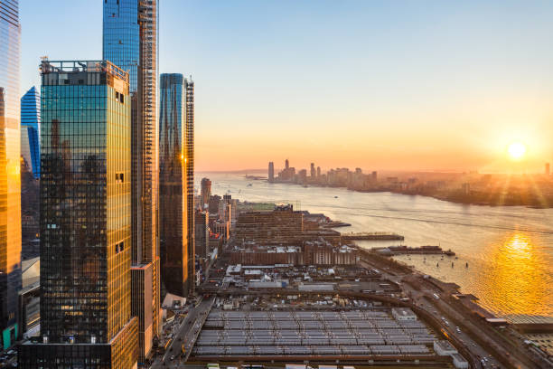 Aerial New York City waterfront skyline Aerial New York City waterfront skyline at sunset viewed from Hudson Yards towards Jersey City accross Hudson River. hudson river stock pictures, royalty-free photos & images