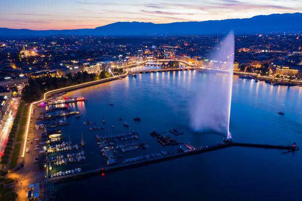 Aerial  night view of Geneva city water fountain in Switzerland stock photo