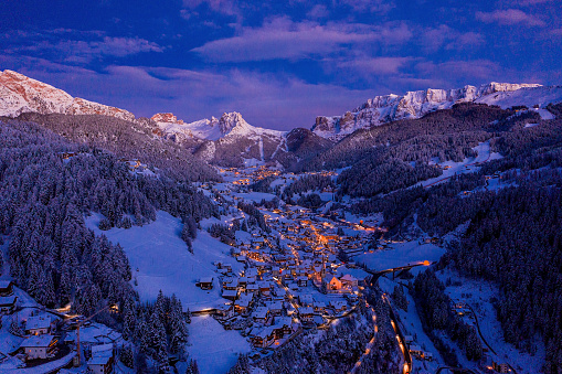 Aerial night view of the Val Gardena ski resort mountain village in Dolomites.