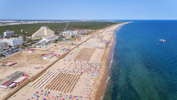 Aerial. Numerous tourists on the Monte Gordo beach. View from sky. stock photo