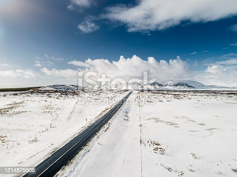 Country road in Iceland on a snowy winter's day in beautiful nature covered in white