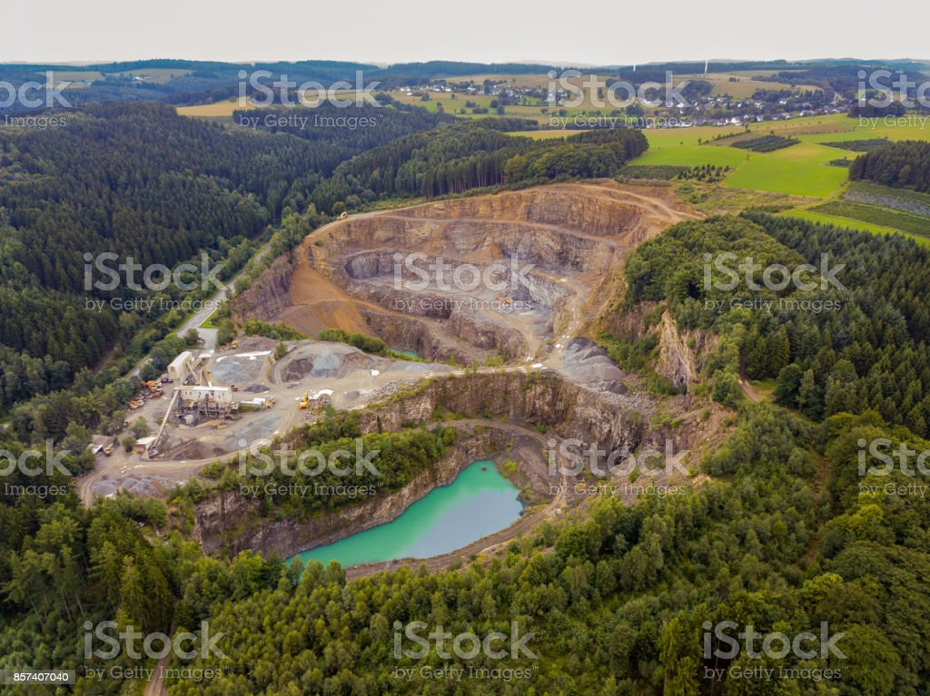 Aerial of an asphalt opencast mine in Reichshof - Germany stock photo