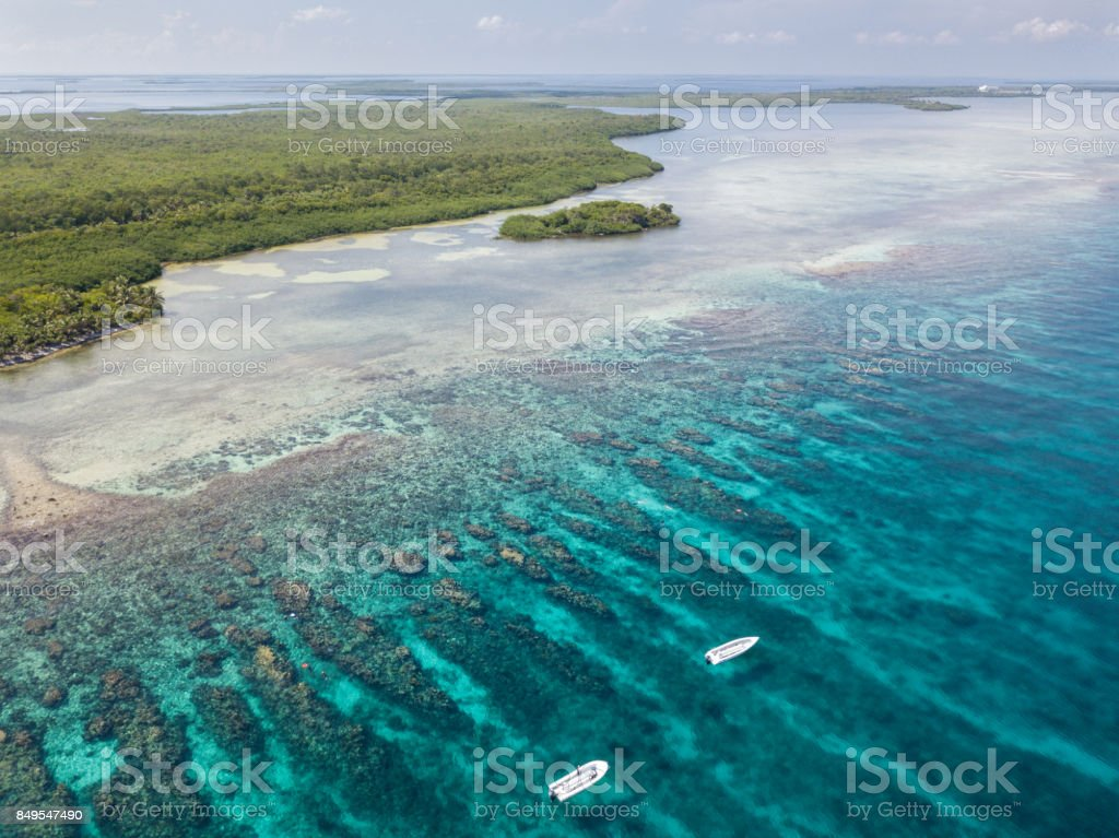 Aerial of Boats and Reef in Belize stock photo