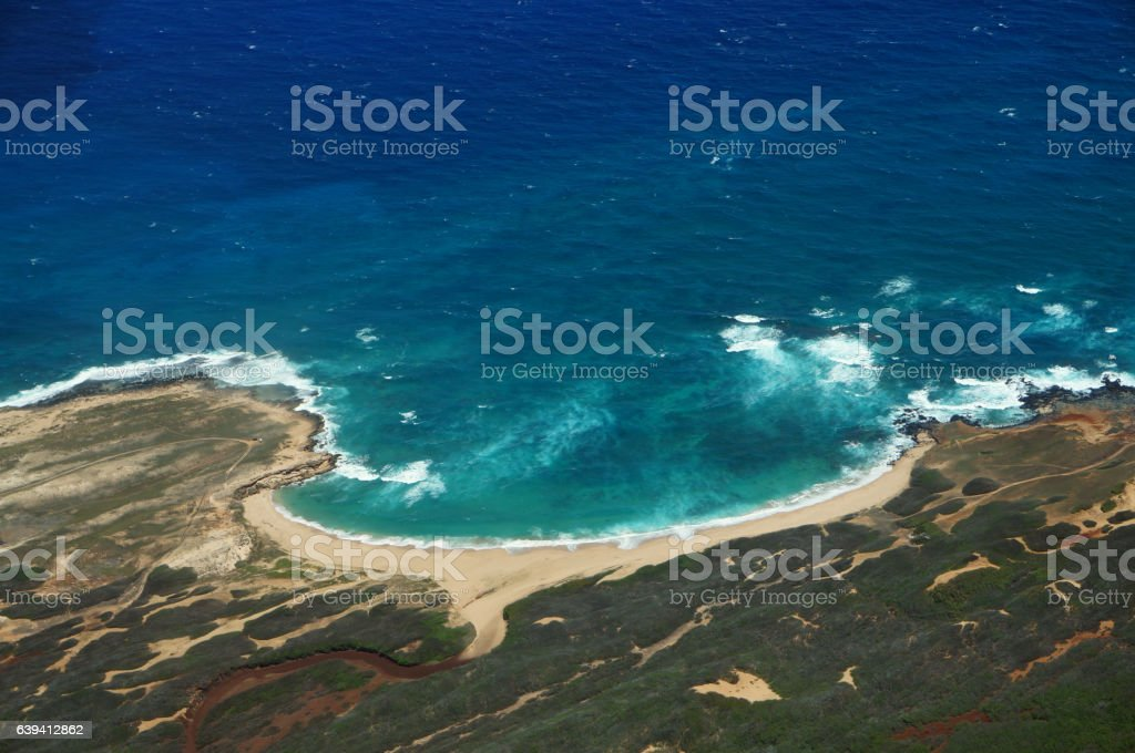 Aerial of coastline of Molokai with waves crashing into Mo'omomi beach stock photo