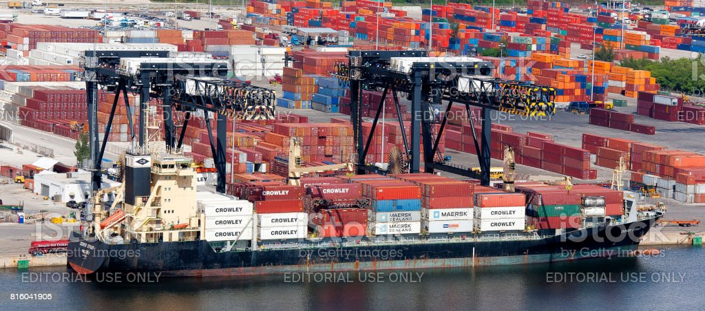 Aerial of container ship unloading Port Everglades Florida stock photo