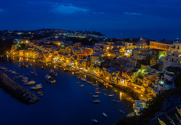veduta aerea di corricella sull'isola di procida a notte. - procida foto e immagini stock
