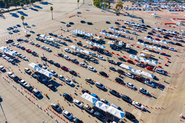 Aerial of Covid-19 Vaccine Distribution in Parking Lot stock photo