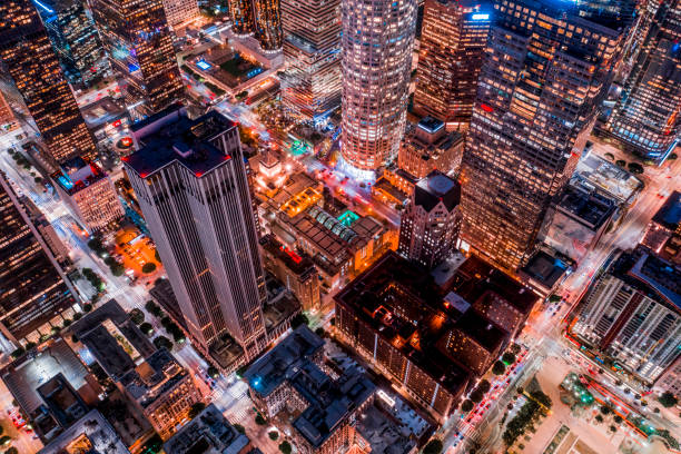 Aerial of Downtown Los Angeles California at Night An aerial view of Los Angeles, California at night with a cyberpunk color treatment downtown district stock pictures, royalty-free photos & images