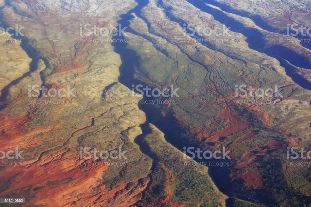 Aerial of dry countryside with creek running down center stock photo