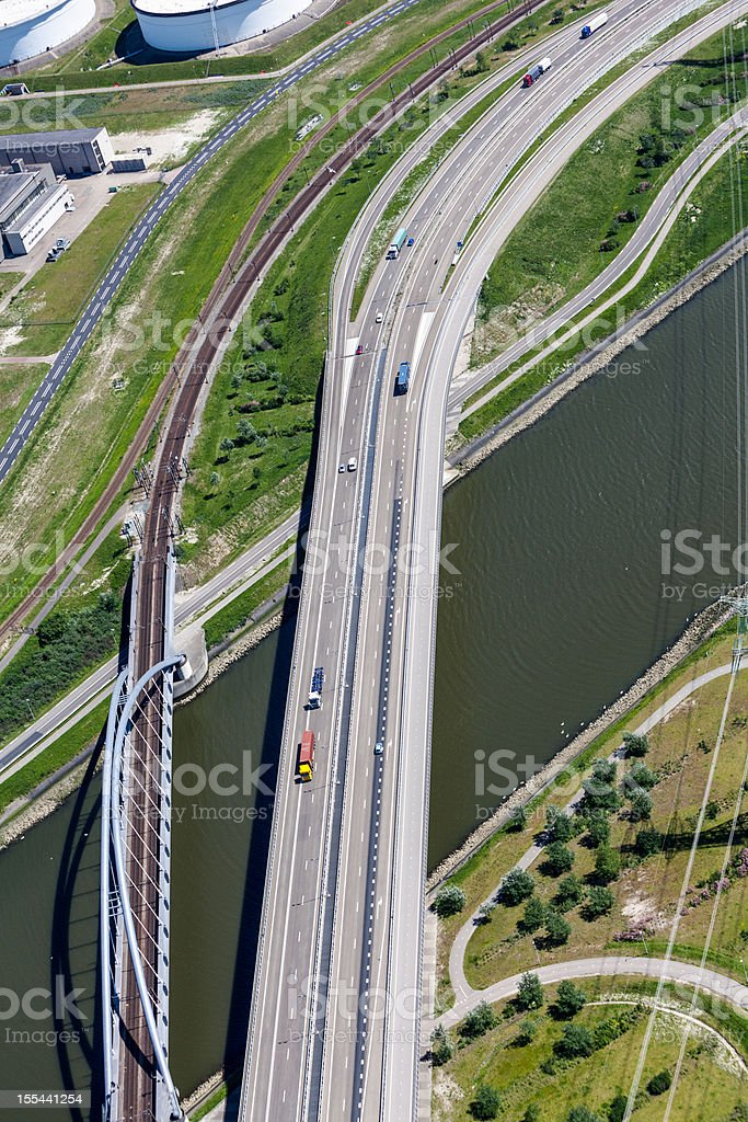 Aerial of highway and railroad crossing a canal royalty-free stock photo