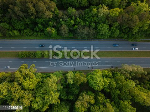 1042711480 istock photo Aerial of Highway through Forest in the Spring 1145939514