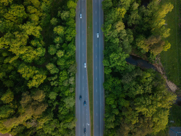 Aerial of Highway through Forest in the Spring stock photo