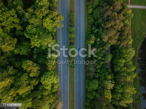 1042711480 istock photo Aerial of Highway through Forest in the Spring 1145939535