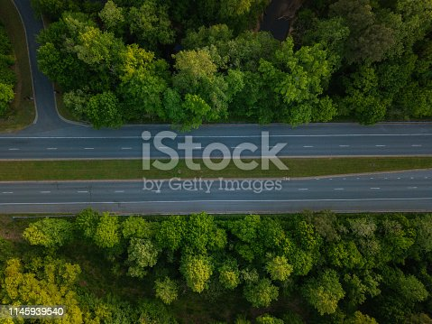 1042711480 istock photo Aerial of Highway through Forest in the Spring 1145939540
