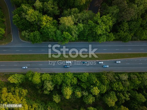 1042711480 istock photo Aerial of Highway through Forest in the Spring 1145939546