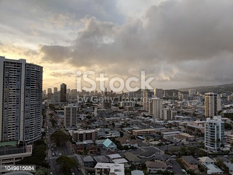 Honolulu -  April 21, 2018:  Aerial of Honolulu Cityscape featuring Buildings, parks, hotels, punchbowl crater and Condos with Pacific Ocean stretching into the distance at dusk on a nice day.