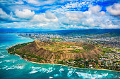 The beautiful coastline of Honolulu Hawaii shot from an altitude of about 1000 feet during a helicopter photo flight over the Pacific Ocean with Diamond Head in the foreground.