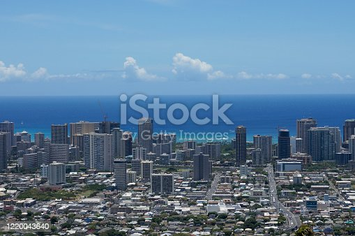 Honolulu - February 11, 2013:  Aerial of Honolulu, Waikiki, Buildings, parks, Crane, hotels and Condos with Pacific Ocean and boats stretching into the distance on great day.