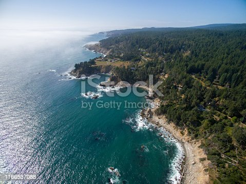 Drone aerial of northern California coast with forest and ocean