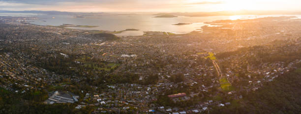 Aerial of Peaceful Sunset and San Francisco Bay Area Late evening light shines on the East Bay and San Francisco Bay in Northern California. This region of the west coast is densely populated but is not far from Lake Tahoe and Yosemite National Park. alameda california stock pictures, royalty-free photos & images