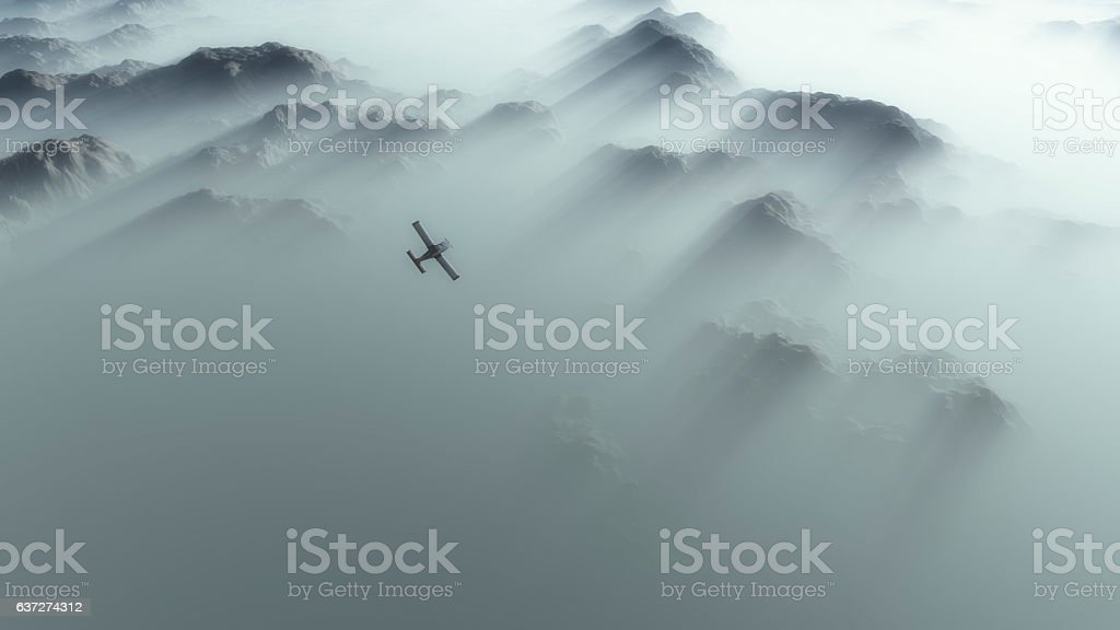Aerial of single engine airplane over mountain range. stock photo
