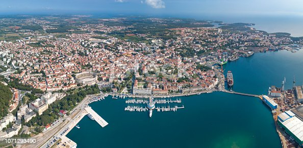 Aerial of the beautiful city Pula with its famous Arena Amphitheater, Marina and Harbor, Croatia. Converted from RAW.