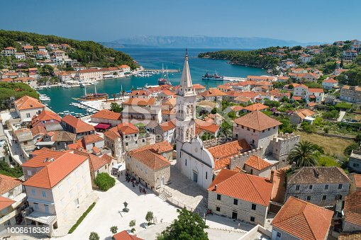 Unique aerial of the beautiful croatian harbor town Jesla with its famous St. Mary's Church. Located on the Island Hvar in the Adriatic Sea. Croatia. You can even see the Croatian Mainland in back. Converted from RAW.
