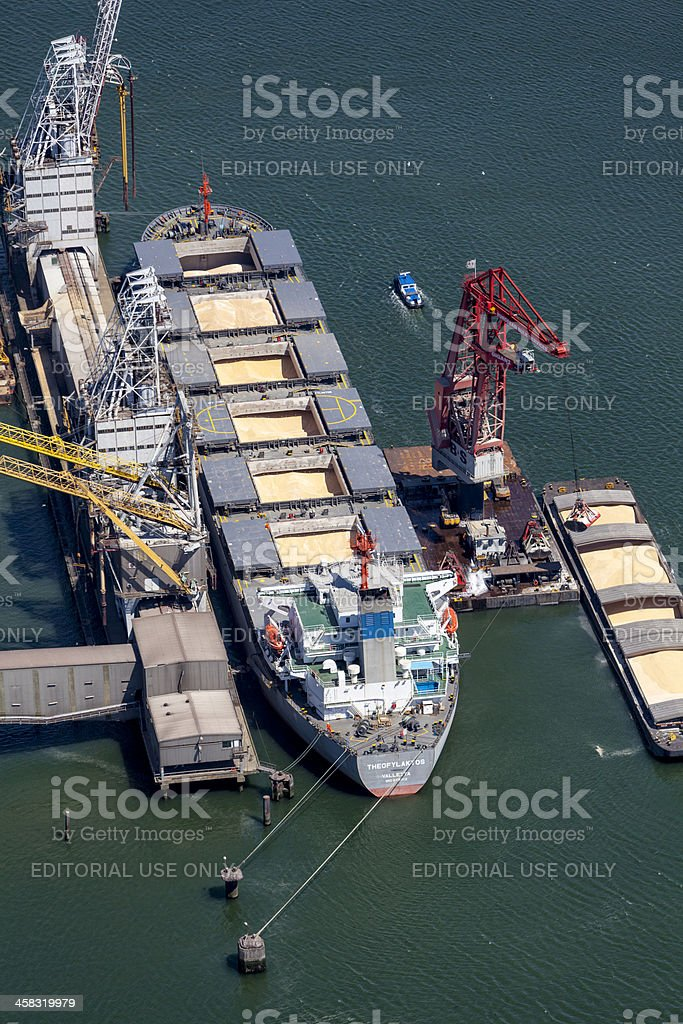 Aerial of Theofylaktos being unloaded by a floating crane stock photo