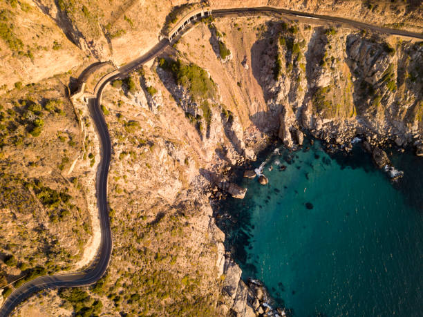 Aerial of winding coastal road stock photo