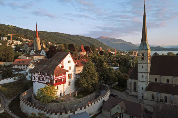 Aerial of Zug, Switzerland Aerial drone image of Zug, Switzerland with focus on the Zug Castle, Catholic Church of St Oswald and St Michel further in the background. zug stock pictures, royalty-free photos & images