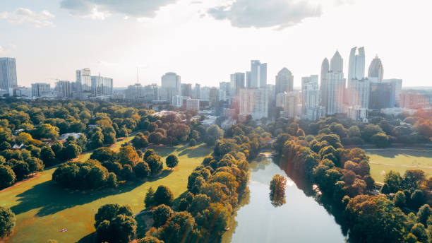 Aerial over Piedmont Park with Atlanta, GA Skyline stock photo