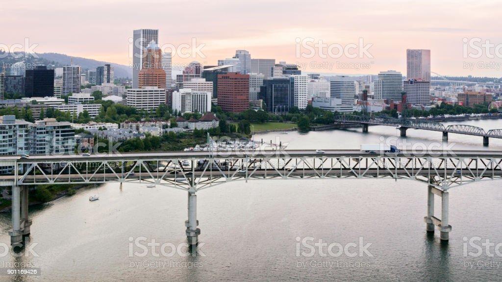Aerial over Tilikum Crossing and Marquam Bridge on Willamette River in Portland stock photo
